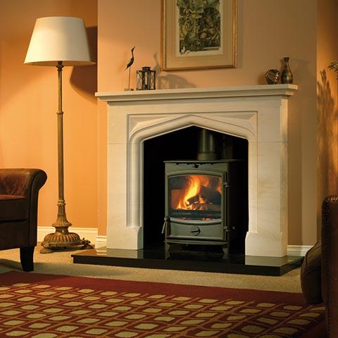 log burner with limestone surround