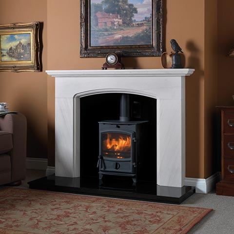wood bruning stove with marble surround