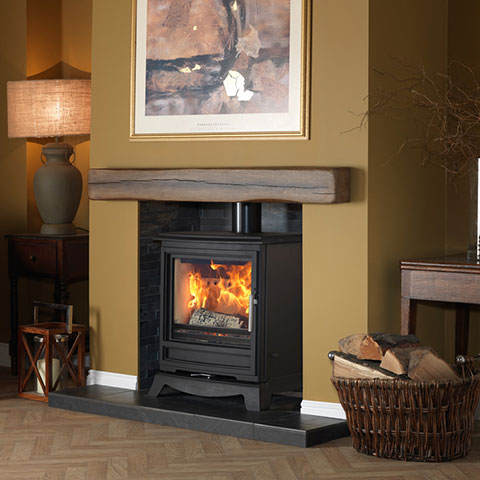 multi fuel stove with wooden beam