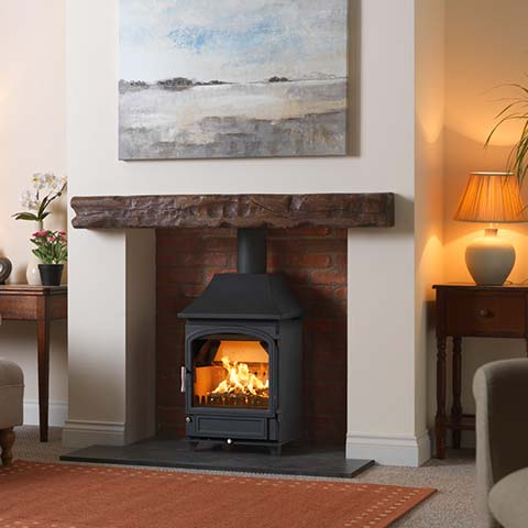multi fuel fireplace with beam