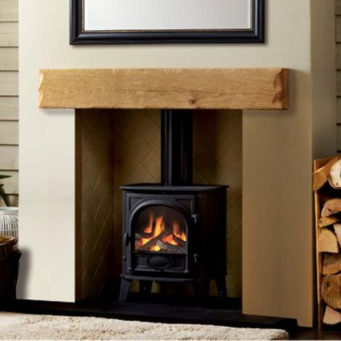 stove with wooden fireplace beam