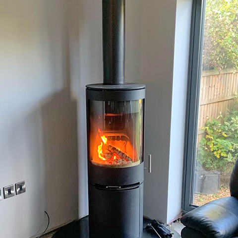 PVR cylinder stove with high log store