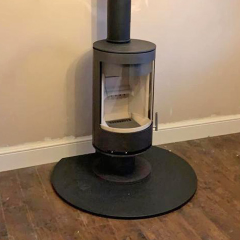 PVR Cylinder stove on low pedestal in metallic grey