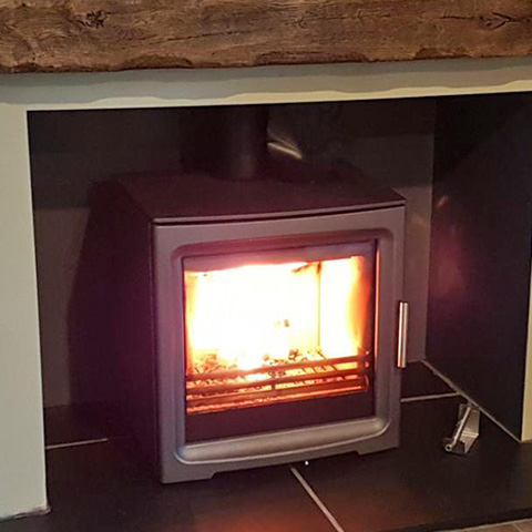PV5W in metallic grey from Charlton and jenrick , on natural slate hearth , geocast oak beam